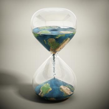 Hourglass shows sands from one world slipping down into globe of second world.