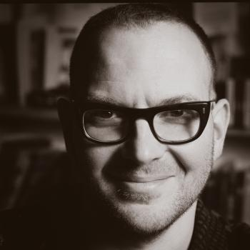 Headshot of science fiction author, Cory Doctorow
